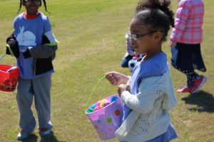 young girl with Easter egg basket filled with eggs