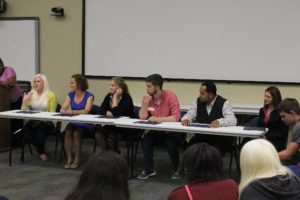 Panel of speakers answering questions during youth event
